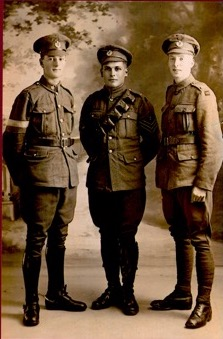3 soldiers in WWI dress on leave in Paris