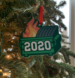 """An ornament on a Christmas tree which is a cartoon garbage dumpster on fire with '2020' superimposed on it"""
